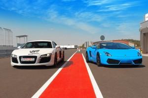 Białe Audi R8 i niebieskie Gallardo na torze